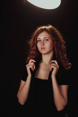 portrait of a glamorous young woman on dark = photo