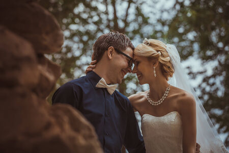 Beautiful young  bride and  groom in a park