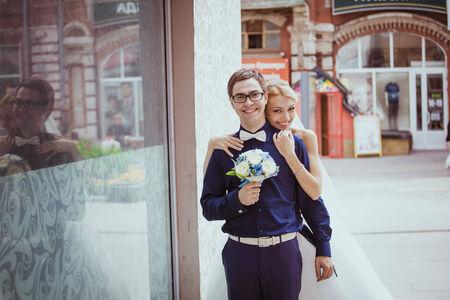 Bride and groom having fun in an oldtown