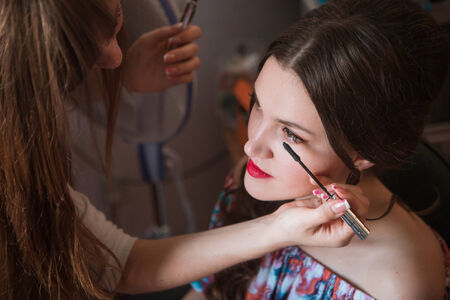 Beautiful bride with wedding makeup  and hairstyle, attractive newlywed woman have final preparation for wedding. Bride waiting groom. Happy newlywed. Marriage. Wedding day moments. Bride makeup.