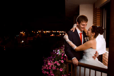 groom and bride at  night photo