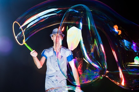 Man with big soap  bubbles