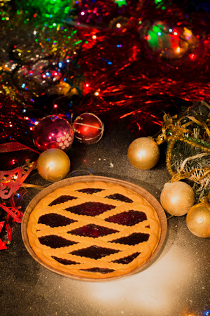 Assortment of traditional Christmas mince pies  with christmas background photo