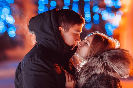Young couple in love outdoor filtered photo with flash flare photo
