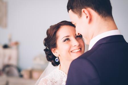 vintage bride: Happy bride and groom in studio