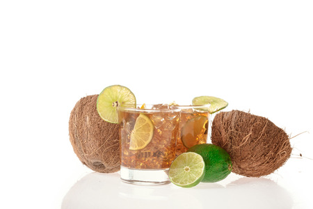 Fresh Fresh cocktail with cola drink coconut and lime fruit on white background photo