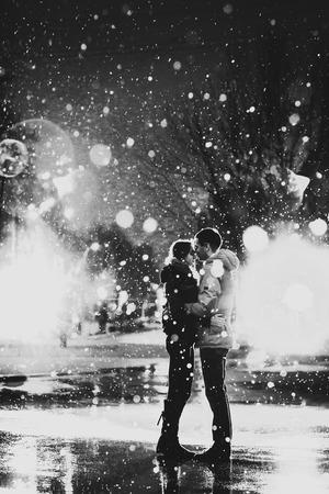 love in rain: Love in the rain  Silhouette of kissing couple Stock Photo