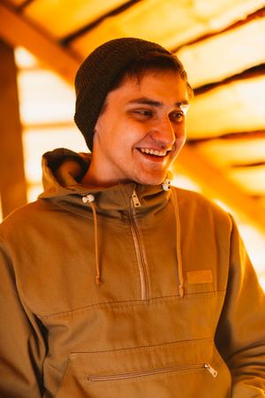 village man: Man hipster wearing waxed canvas jacket with village backhround Stock Photo
