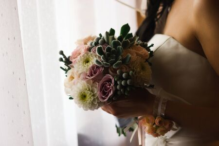 Beautiful wedding bouquet  of flowers in hands  the bride Stock Photo