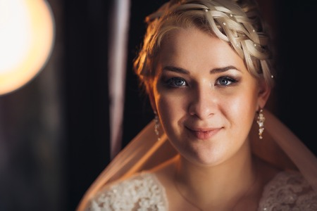 Portrait of  bride  on the classic dark background