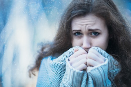 beautiful sad: ill young girl  on a cold winter background