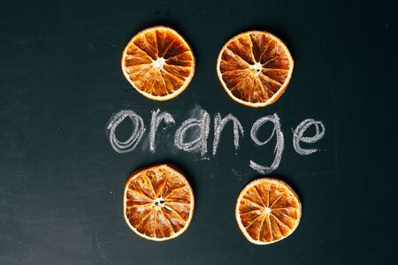 cup four: four cup sliced orange on a black background  board Stock Photo