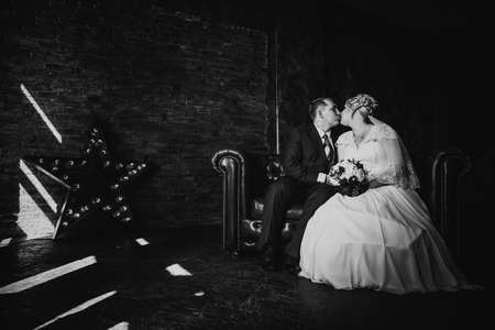 black and white photography: Black white  photography  beautiful young  couple suit on a dark background