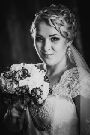 black and white photography: Black white  photography portrait of  bride  on the classic dark background