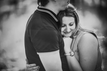 black and white photography: Black white photography romantic young couple kissing  on background summer forest