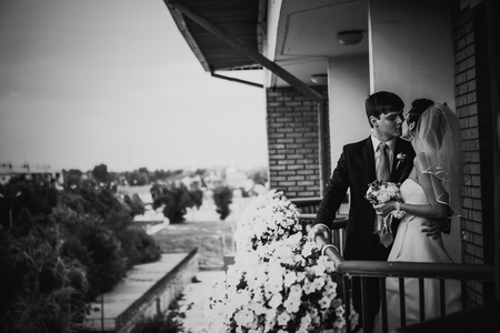 black and white photography: Black white  photography beautiful young couple stand on the balcony