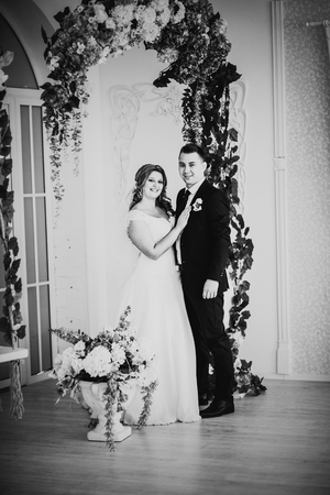 black and white photography: Black white photography  bride and groom posing  in a hotel room