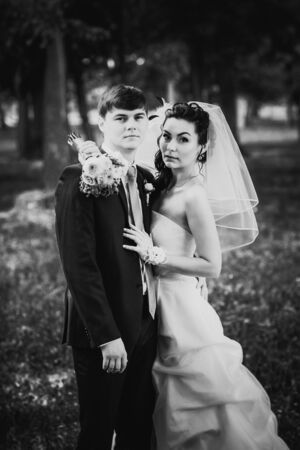 black and white photography: Black white photography  wedding beautiful young couple stand on background forest Stock Photo