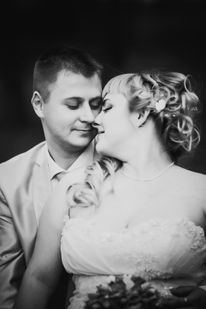 black and white photography: Black white  photography beautiful wedding young couple stand on  background forest