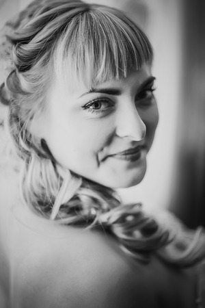 black and white photography: Black white  photography portrait of  bride  on the classic bright background Stock Photo
