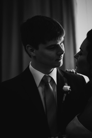 black and white photography: Black white photography beautiful young  couple standing near the window