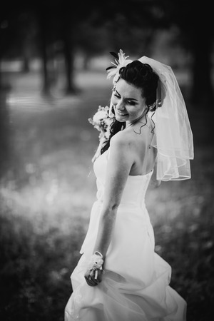 black and white photography: Black white photography beautiful young bride stand on  background forest Stock Photo