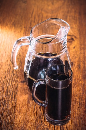 tankard: Russian brew in mug and jug of rye  flour on wooden background