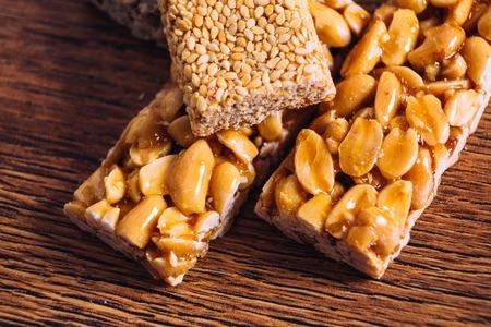 Kozinaki of sesame and peanut  on a wooden background