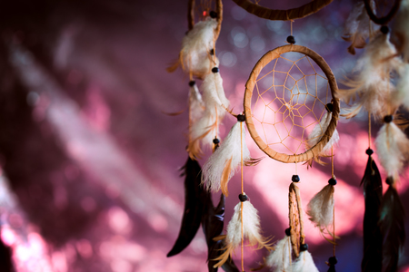 Dreamcatcher against a background of purple sunset dark background. Stock Photo