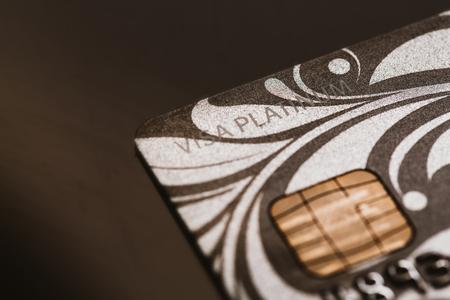 silver bars: Samara, Russia-July 25.2016: Visa platinum credit card close-up.