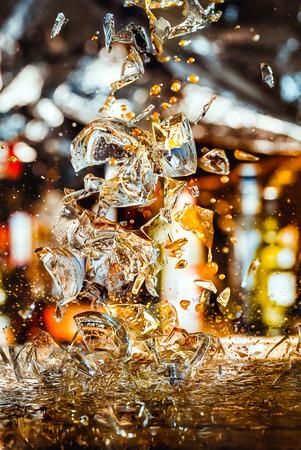 shards: Shards of broken glass on blurry background Stock Photo