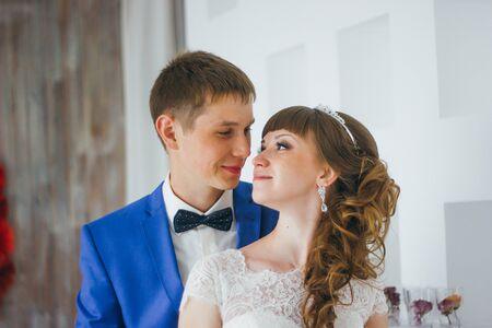 young bride and groom in interior design studio.