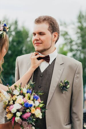 young bride and groom on the background of nature.
