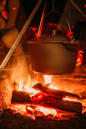 boiling pot: boiling pot over an open fire on a blurred background.