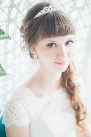 Portrait of a young happy bride in studio. Stock Photo
