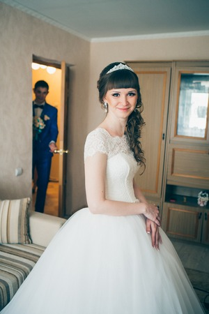 young bride waiting for the groom in house.
