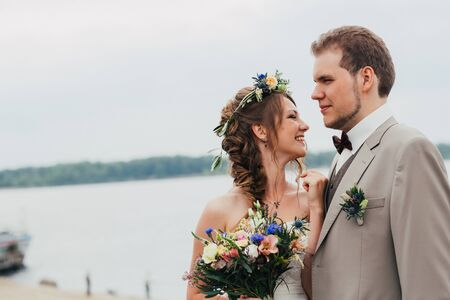 young happy bride and groom on the background of nature.