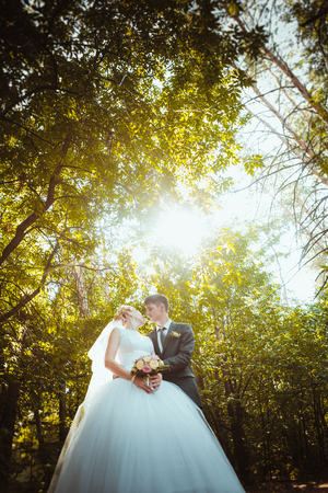 pompous: bride and groom on the forest background.