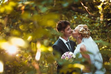 bride and groom on the forest background.