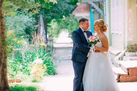 bride and groom on the background of the city
