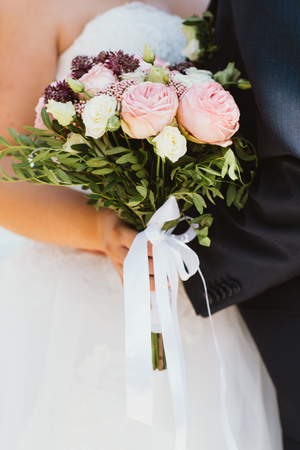 fresh bridal bouquet of roses different colors