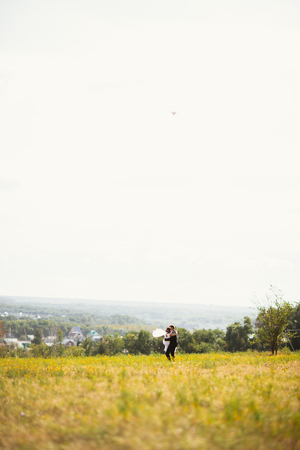 couple bride and groom on field background. Stock Photo