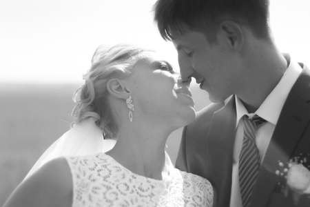 black and white photo the bride  groom on the background of fiel Stock Photo