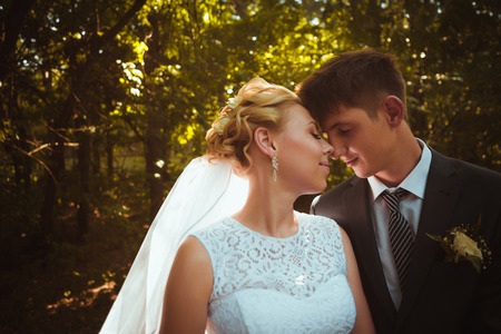 portrait of the bride and groom on the forest background