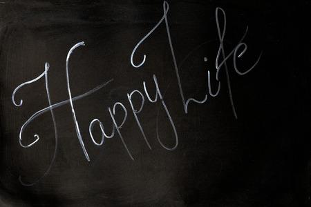Inscription happy Life on black background Stock Photo