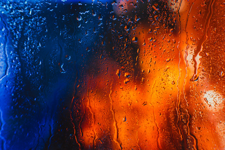 defocussed: Drops of rain on the window of the car in the evening Stock Photo
