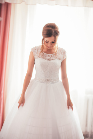 portrait of a young bride on a light background