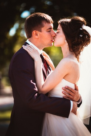 young couple groom and the bride on the park background Stock Photo