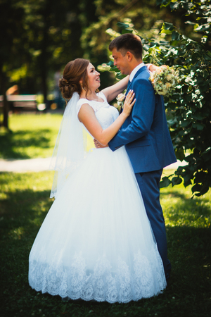 couple groom and bride on a park background in full growth