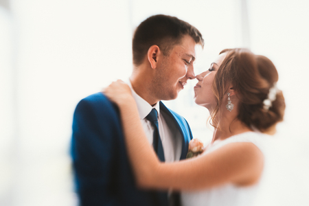 couple groom and bride against the background studio